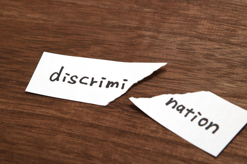 Cut Diversity Protest Split Word Break Bullying Communication Conflict Discriminate Discrimination Elimination Equality Handwriting  Hate Message Messages No People Note Paper Racecar Studio Shot Tear Text Wood - Material