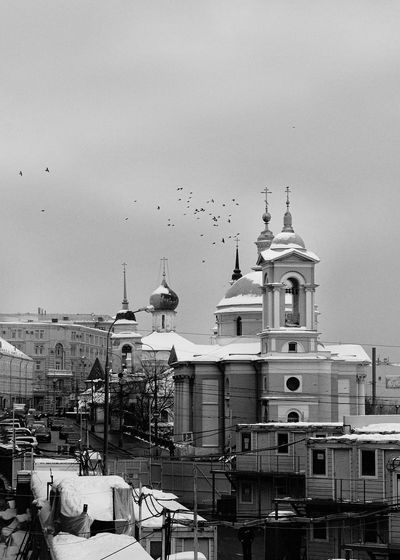 View Of Church In City Against Sky