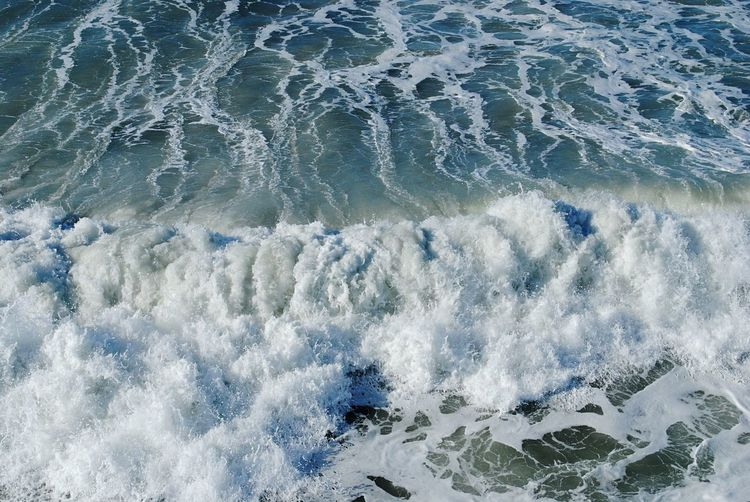 Close-up of wave on shore