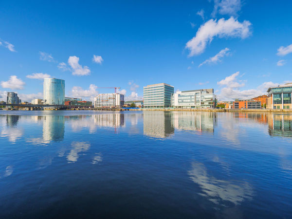 riverbank of River Lagan, Belfast City, Northern Ireland, United Kingdom Bridge Waterfront Skyscraper Reflection Outdoors Sky Clear Sky Modern Day City Built Structure Building Exterior Architecture Northern Ireland Blue Belfast Water Business Nobody Landsacpe Urban Skyline No People