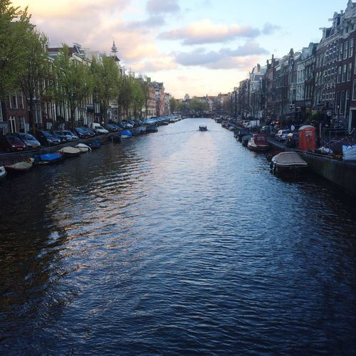 Mesmerising canal in Amsterdam in April. Canal Waterfront City Amsterdam Cityscapes