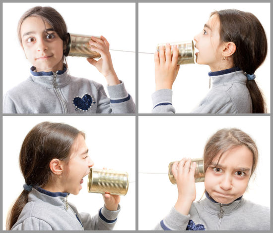 little girl playing on the phone built with the jar Astonishment Child Communication Concept Conceptual Ear Jar LINE Listen Phone Play Portrait Telephone Tin Toy