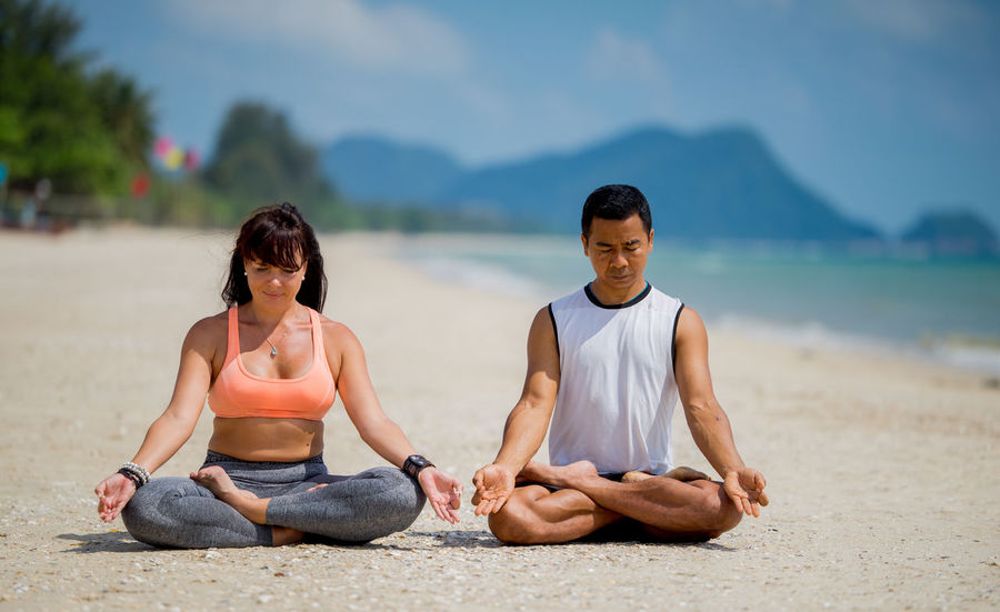 Beauty In Nature Casual Clothing Cross-legged Day Exercising Healthy Lifestyle Leisure Activity Lifestyles Lotus Position Meditating Mountain Nature Outdoors Practicing Real People Relaxation Sitting Togetherness Tranquil Scene Two People Wellbeing Yoga Young Adult Young Men Young Women