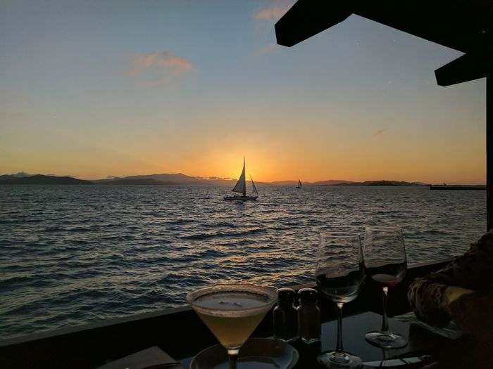 Sailboat and sunset Sea Sunset Beach Horizon Over Water Tranquility Water Tourism Sky Travel Business Finance And Industry Vacations No People Travel Destinations Nautical Vessel Fishing Alcohol Relaxation Outdoors Sand Silhouette First Eyeem Photo