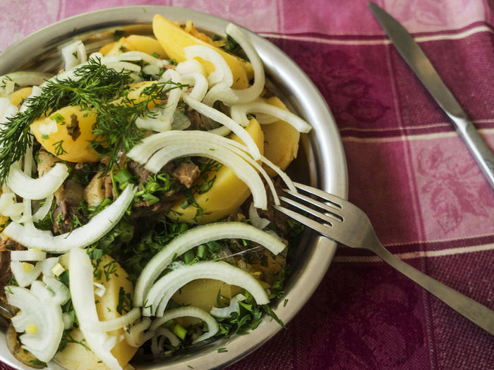 Close-up of food in bowl on tablecloth