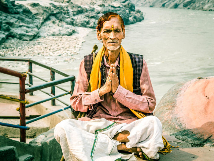 Portrait of smiling man sitting on beach