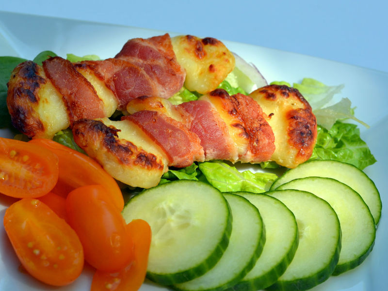Bacon Wrapped Haloumi (Halloumi) Cheese Salad Plate; ketogenic and low carbohydrate meal Cucumber Dinner Keto Lunch Bacon Bacon Wrapped Cherry Tomatoes Close-up Food Food And Drink Freshness Green Color Halloumi Cheese Healthy Eating Ketogenic Diet Salad Ketogenic Meal Low Carb Low Carb Meal Low Carbohydrate Meal Meat Ready-to-eat Serving Size SLICE Supper