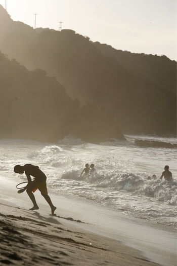 Tourists Enjoying On Beach