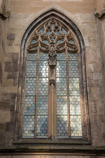 Window of an old historical building Architecture Built Structure Religion Window Building Belief Place Of Worship Day Spirituality No People Building Exterior Arch History Art And Craft The Past Low Angle View Glass - Material Glass Ornate