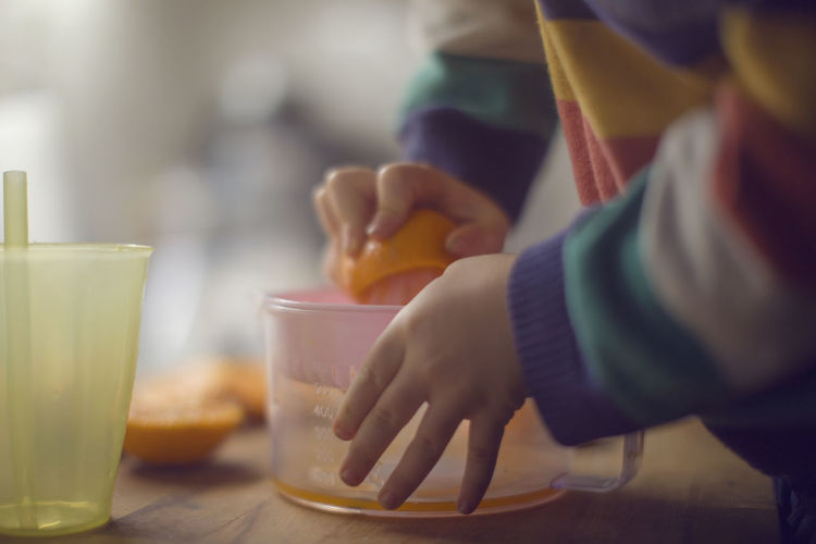 Chief Child Holding Human Hand Orange - Fruit Orange Color Orange Juice  Two Hands