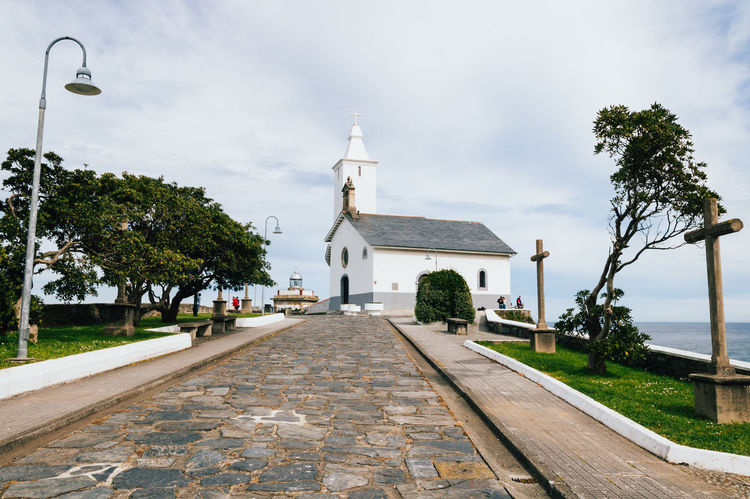 Lighthouse and hermitage Architecture Asturias Church Composition Cross Cross Exterior Hermitage History Landmark Leading Lighthouse Luarca Outdoors Perspective Religion Sea Sidewalk Spirituality The Way Forward Way