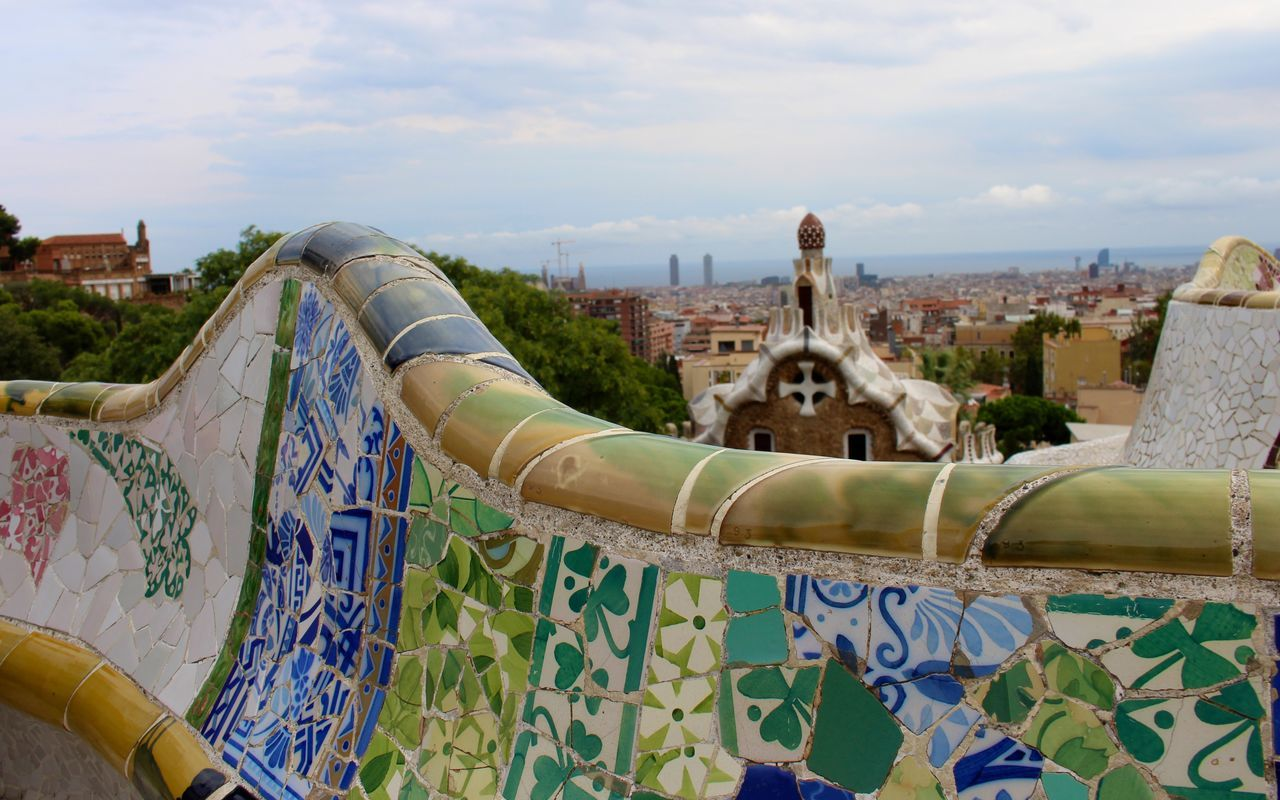 Mosaic Tile Bench At Park Guell Against Sky