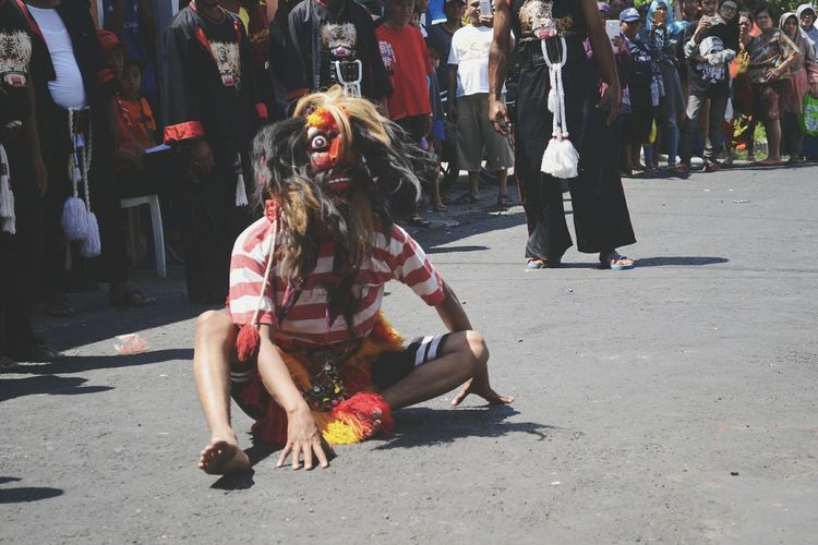 Man in costume performing on road