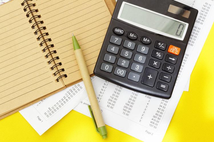 Financial concept Small Business Concept Conceptual Financial Planning Counting Business Corporate Business Paper Calculator Finance Savings Financial Figures Budget Office Bill Tax Calculating