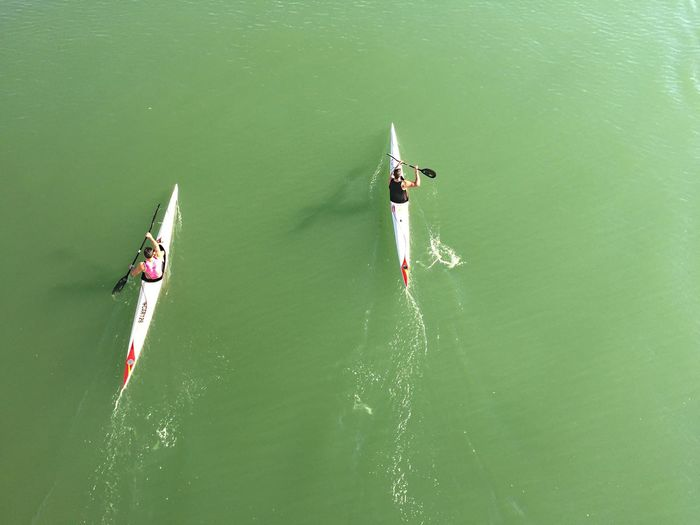 High angle view of men kayaking in river