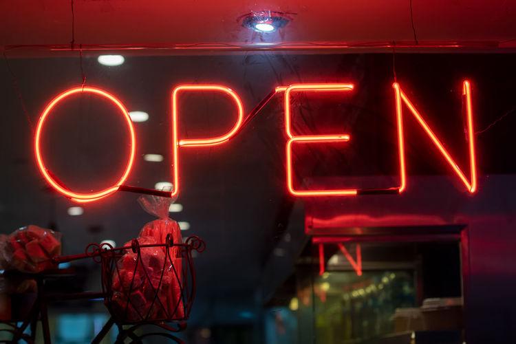 Illuminated open sign at night