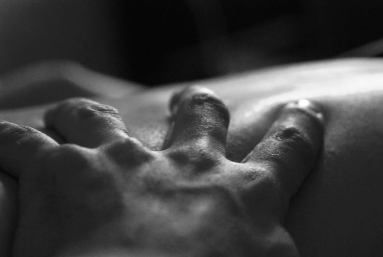 Close-Up Image Of Hand On Back