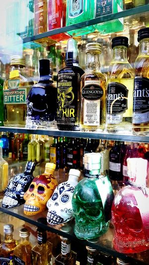 Variation Choice Large Group Of Objects Group Of Objects Abundance Collection Reflection Retail  Multi Colored In A Row Arrangement Retail Display Shelf Variety Unhealthy Eating No People The Color Of Business Alcohol Alcohol Bottles Skulls Skull Face Elixir Absinthe Absinth & Laudanum Prague