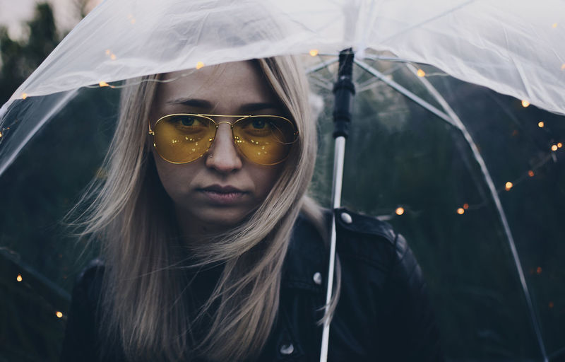 Portrait Of Young Woman Holding Umbrella