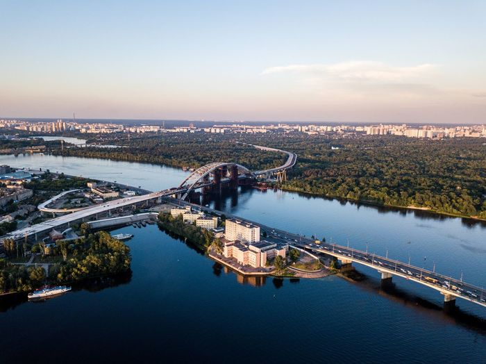 High angle view of bridge over river in city against sky