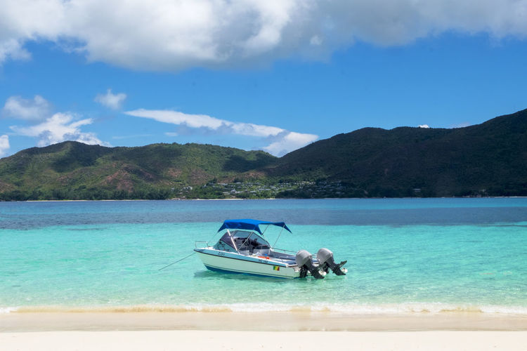 Seychelles Beauty In Nature Blue Cloud - Sky Day Idyllic Land Mode Of Transportation Mountain Mountain Range Nature Nautical Vessel Non-urban Scene Outdoors Scenics - Nature Sea Sky Tranquil Scene Transportation Travel Turquoise Colored Water