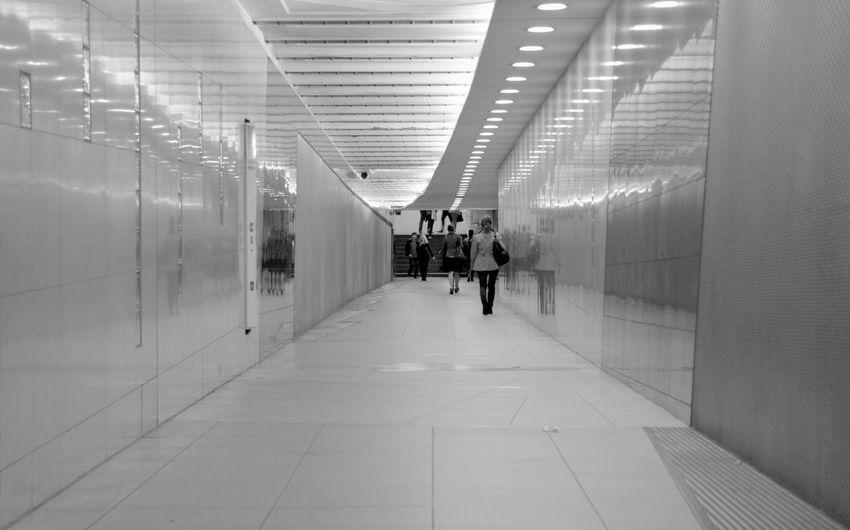 People Walking In Underground Walkway