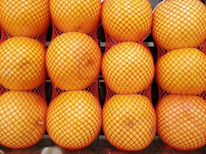 Close-up of oranges in nets