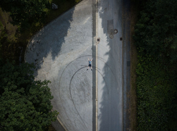 High Angle View Of Man Lying On Road