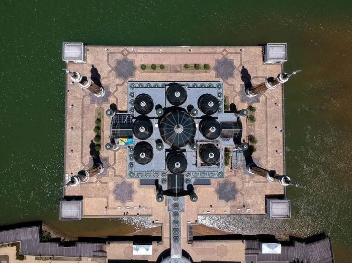 Aerial view of buildings against sea