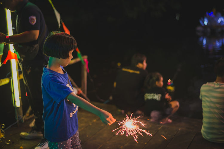 Arts Culture And Entertainment Boys Celebration Childhood Firework - Man Made Object Firework Display Illuminated Lifestyles Long Exposure Men Night Outdoors People Real People Sparkler Standing Women