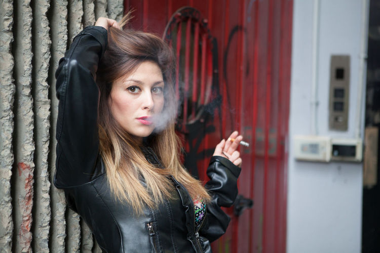 M. The Girl In A Black Leather Suit smoke a Cigarette Adult Beautiful People Beautiful Woman Beauty Cigarette  City Day EyeEm Best Shots Fashion Females Leisure Activity Lifestyles Long Hair One Person Outdoors People Portrait Smoke Smoking Teenage Girls Teenager The Week On EyeEm Young Adult Young Women Youth Culture