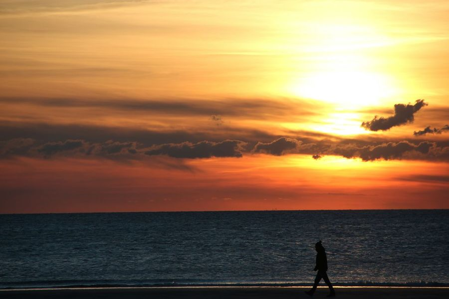Sunset Horizon Over Water Sea Water Scenics Beach Tranquil Scene Vacations Beauty In Nature Tranquility Tourism Silhouette Idyllic Standing Cloud - Sky Dusk Tourist Sky Men Nature Germany Sylt Man Walking On Beach Skyporn