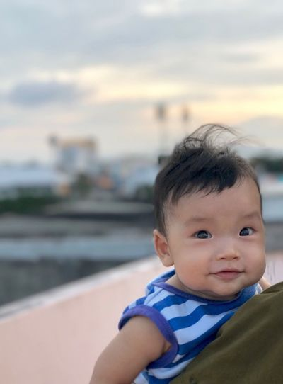 Little baby smiling People Happiness Parent Mother Father Smiling Sunset Son Kids ASIA Love Background School Child Real People Childhood Baby One Person Portrait Young Cute Babyhood Innocence Focus On Foreground Looking Looking Away Toddler  Lifestyles Headshot Outdoors