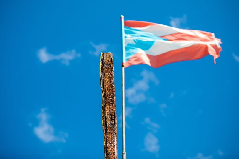 EyeEm Selects Flag Patriotism Blue Low Angle View Sky Day No People Cloud - Sky Outdoors Close-up
