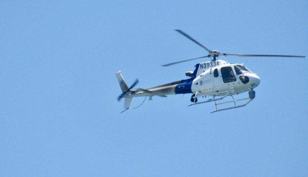 Air Vehicle Helicopter Clear Sky Low Angle View Sky Law Enforcement Flying Blue CBP Helicopter