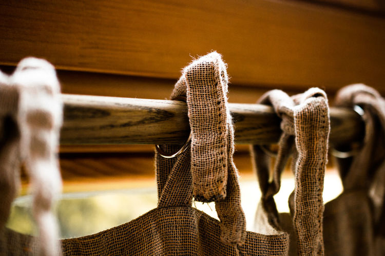 Close-Up Of Textile Hanging On Wooden Rod