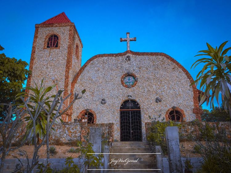 Malbato Church Architecture Religion Built Structure Spirituality Belief Building Exterior Place Of Worship Building Sky Plant Clear Sky Blue Cross Tree Ornate Nature No People Day Summer Road Tripping