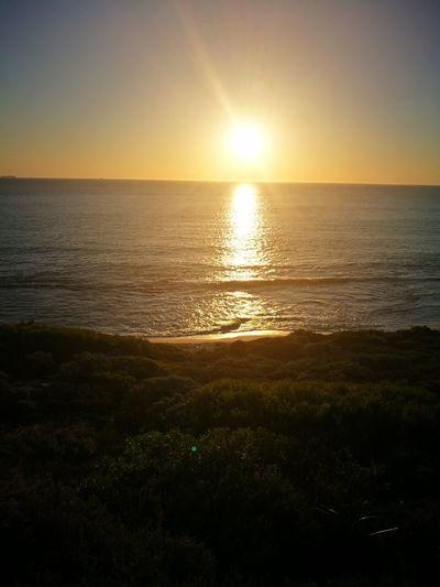 North Beach Perth. Sunset Sea Sun Scenics Horizon Over Water Sunlight Beauty In Nature Nature Sky Beach Tourism Orange Color Sunbeam Reflection Vacations Water Travel Travel Destinations Dramatic Sky Summer