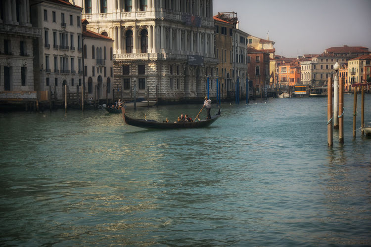 Traditional gondola at grand canal in venice, italy