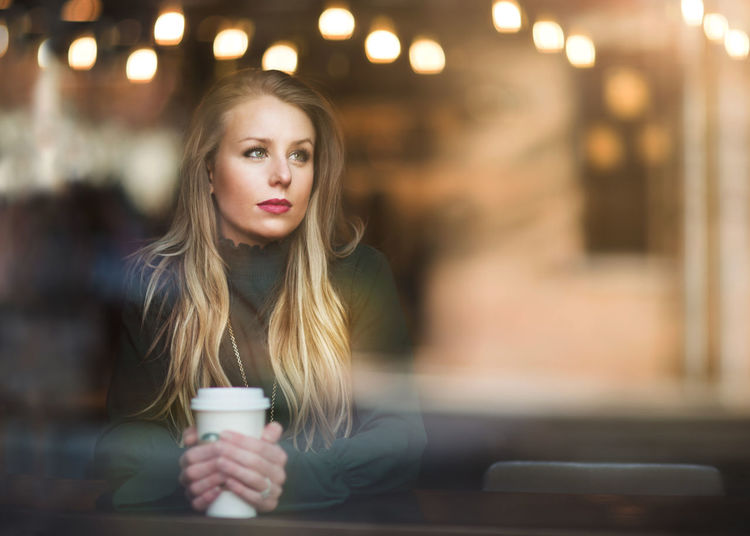 Coffee Shop Beautiful Woman Blond Hair Bokeh Close-up Coffee - Drink Coffee Cup Focus On Foreground Illuminated Indoors  Leisure Activity Lifestyles Night One Person Portrait Real People Through The Window Young Adult Young Women