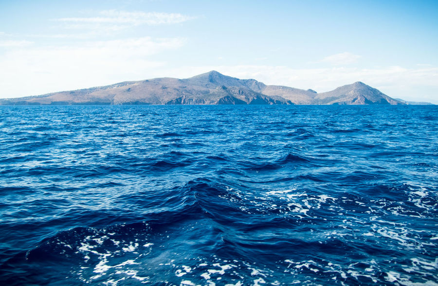 Hope you can swim. Beauty In Nature Blue Day Greece Landscape Mountain Mountain Range Nature No People Outdoors Refraction Rippled Scenics Sea Sea And Sky Seaside Sky Tranquility Water EyeEmNewHere