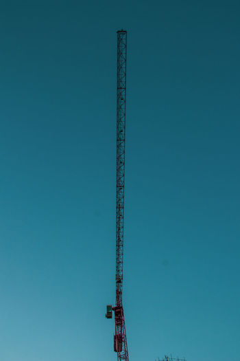 The skis adorned with mechanical birds, a bottom view of carne against the blue sky in dubai.
