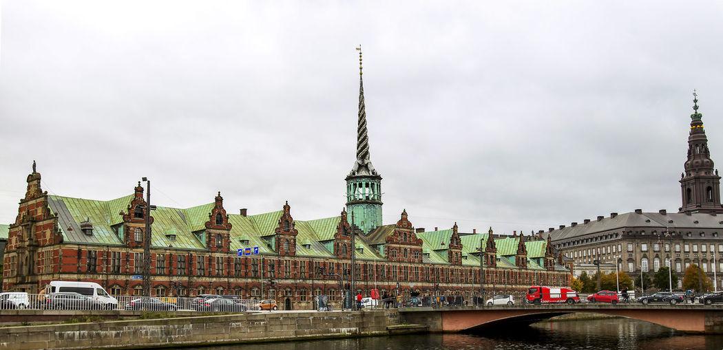 Borsen building and christiansborg palace against sky
