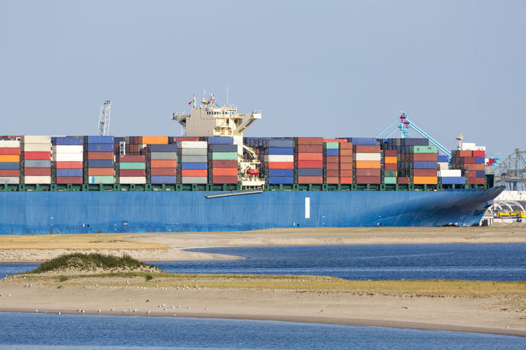 Large container ship Business Cargo Cargo Container Cargo Containers Cargo Ship Container Container Port Container Ship Copy Space Day Export Harbor Import Industry Large Group Of Objects No People Outdoors River Sand Ship Shipping  Shipyard Transportation Water Weather