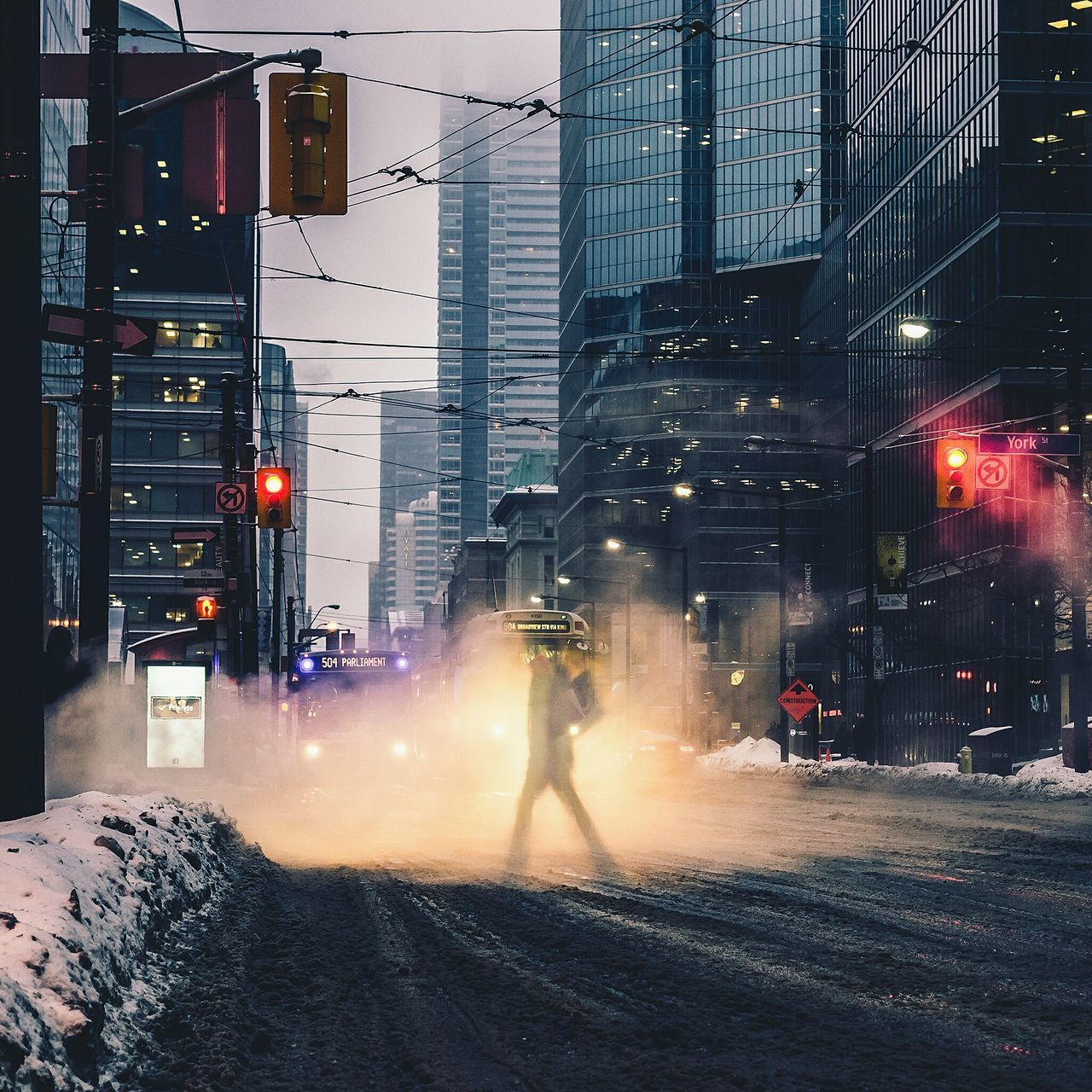 Digital composite image of person crossing street in city during winter