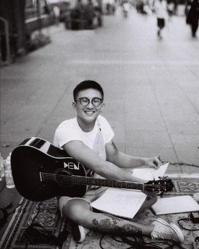 Portrait of smiling man playing guitar