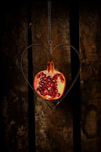 Pomegranate fruit in heart shaped metal ornament Design Food Food And Drink Fruit Heart Heart Shaped  Metal Organic Pomegranate ❤ Pomegranates  Pomegranateseeds Red Simplicity Still Life Studio Shot Wood