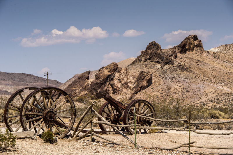 Old Carts By Hill In Ghost Town