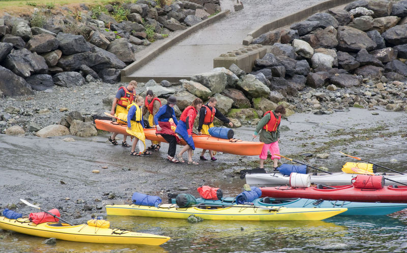 People ready for Sea Kayaking in the Pacific Ocean - Tofino, Pacific Rim National Park, Vancouver Island, British Columbia, Canada Beach British Columbia Canada Canoe Canoeing Canoes Carrying Family Family❤ Kayak Kayaking Kayaking In Nature People Reflective Clothing Rock - Object Sea Sea Kayak Sea Kayaking Sport Sports Team Team Teamwork Togetherness Vancouver Island Water
