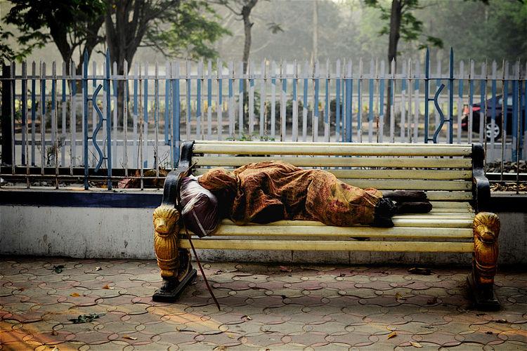 Man sleeping on sidewalk